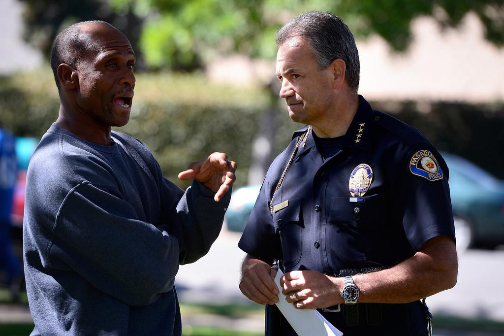 Description of . Pasadena Police Chief Phillip Sanchez talks to a man as Pasadena Police investigate an officer involved shooting at Kings Village in Pasadena Friday, October 11, 2013. (Photo by Sarah Reingewirtz/Pasadena-Star News)
