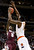 Montana guard Will Cherry (5) shoots against Syracuse forward Rakeem Christmas (25) during the first half of a second-round game in the NCAA college basketball tournament in San Jose, Calif., Thursday, March 21, 2013. (AP Photo/Jeff Chiu)