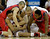 Mississippi guard Marshall Henderson, left, tries to steal the ball from Wisconsin guard George Marshall, bottom left, during the second half of a second-round game of the NCAA college basketball tournament Friday, March 22, 2013, in Kansas City, Mo. (AP Photo/Charlie Riedel)