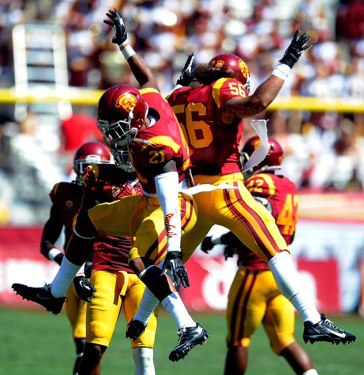 Description of . Southern California safety Su'a Cravens (21) reacts along with linebacker Anthony Sarao (56) after stopping Boston College on fourth down during the second half of an NCAA college football game in the Los Angeles Memorial Coliseum in Los Angeles, on Saturday, Sept. 14, 2013. Southern California won 35-7. 