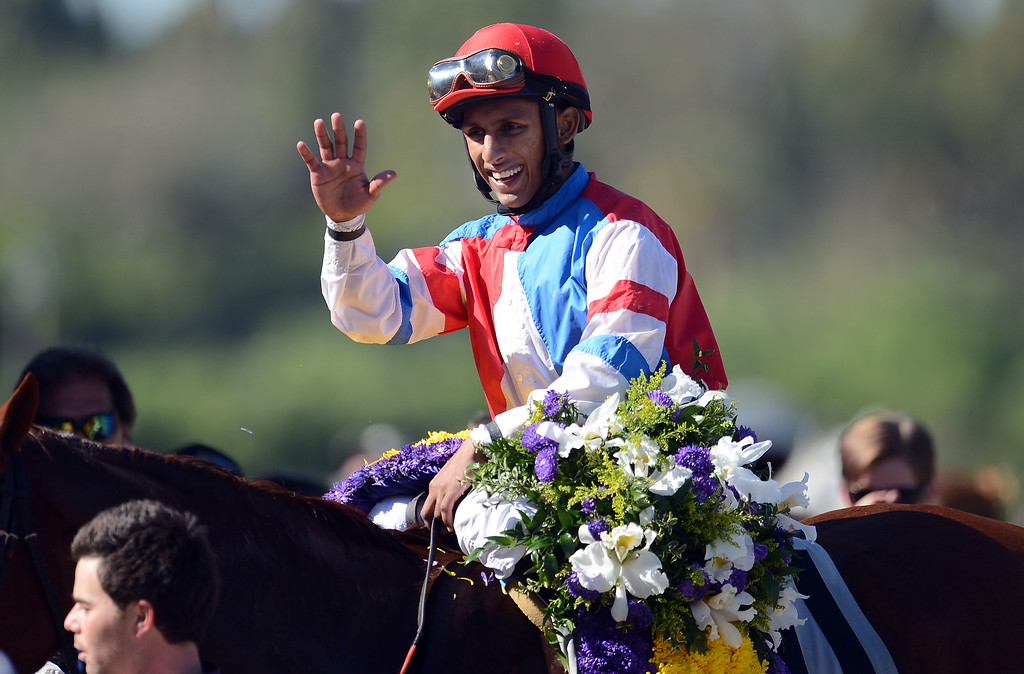 Description of . Jockey Julien Leparoux atop