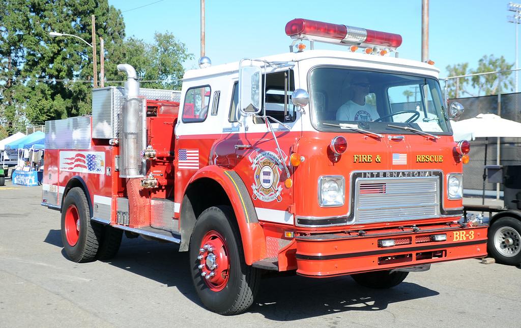 Description of . A vintage fire truck during the 4th annual La Habra Highlanders car show at La Habra High School in La Habra Calif. on Saturday, Sept. 7, 2013.   (Photo by Keith Birmingham/Pasadena Star-News)