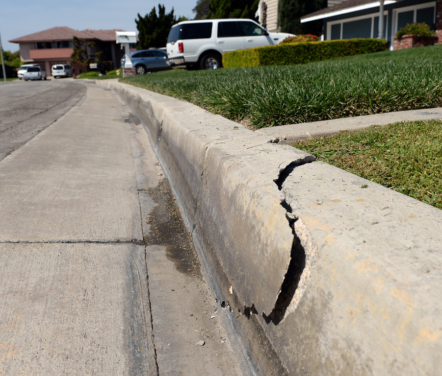 Description of . Residents on Avenida Del Norte in Fullerton can see their curb split on Saturday March 29, 2014 after the 5.1 earthquake centered in La Habra. (Staff Photo by Keith Durflinger/Whittier Daily News)