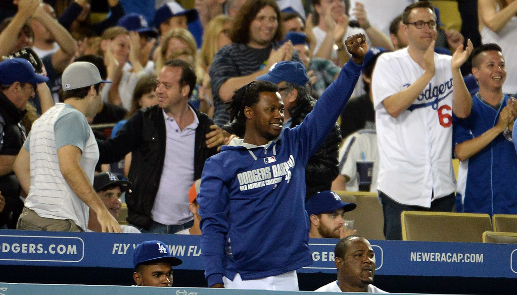 Description of . Los Angeles Dodgers' Hanley Ramirez cheers as teammate Adrian Gonzalez (not pictured) doubles in the ninth inning as the Los Angeles Dodgers defeat the San Diego Padres 1-0 during a Major league baseball game on Saturday, July 12, 2014 in Los Angeles. Los Angeles Dodgers won 1-0.   (Keith Birmingham/Pasadena Star-News)