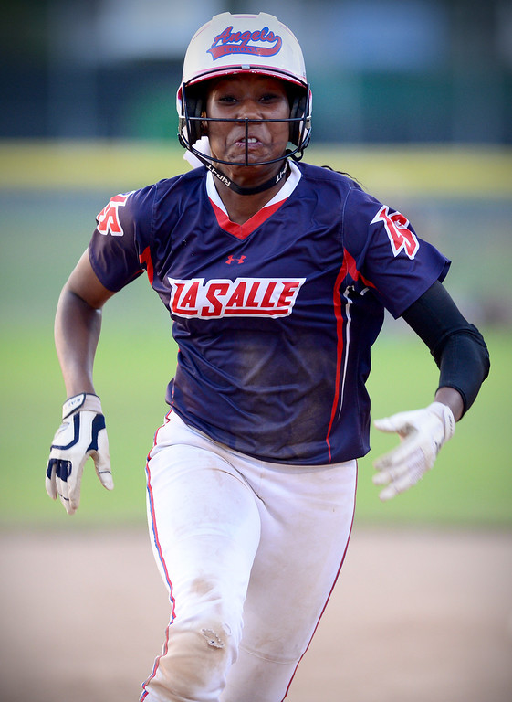 Description of . La Salle's Kinsley Washington (2) runs to third during the West SGV softball all-star game Wednesday night, June 11, 2014 at Live Oak Park in Temple City. (Photo by Sarah Reingewirtz/Pasadena Star-News)