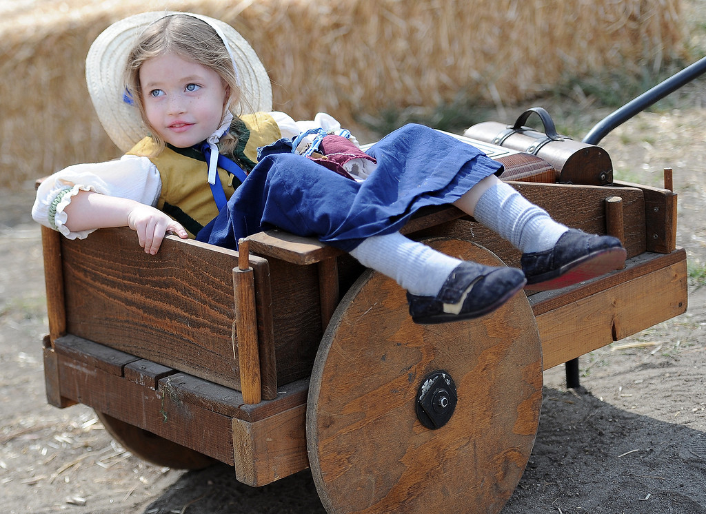 Description of . 4 year-old Meikah Connors of Long Beach during Opening day of the Renaissance Pleasure Faire as many dress in period clothing at Santa Fe Dam Recreation Area in Irwindale, Calif., on Saturday, April 5, 2014. 