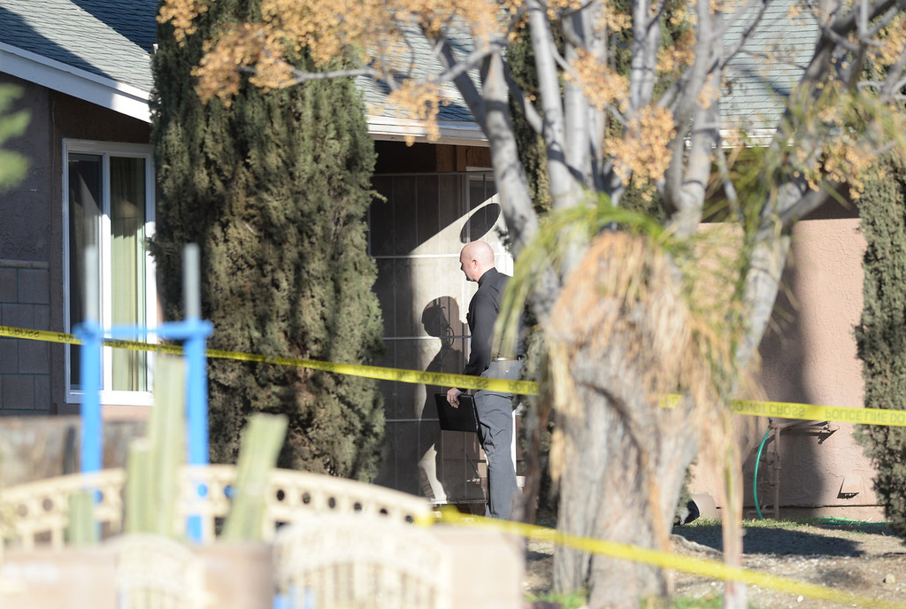 Description of . Fontana Police investigate a homicide where the bodies of a young boy, a young girl and two adults, male and female, were discovered last night by a family member in Fontana. It appeared all four lived in the home, according to Fontana police Sgt. Doug Imhof, Dec. 31, 2013 (John Valenzuela/Staff Photographer)