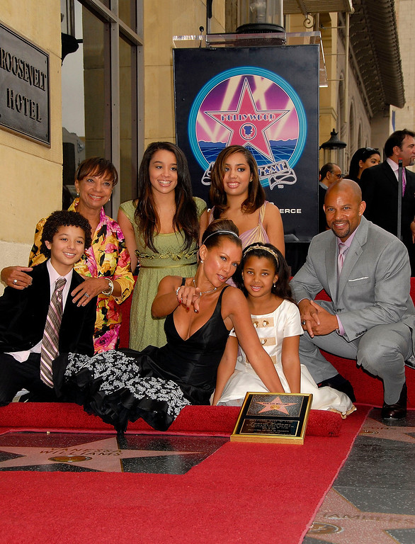Description of . LOS ANGELES, CA - MARCH 19:  Singer-actress Vanessa Williams (C) is joined by her family as she receives a star on the Hollywood Walk of Fame on March 19, 2007 in Los Angeles, California.  (Photo by Charley Gallay/Getty Images)