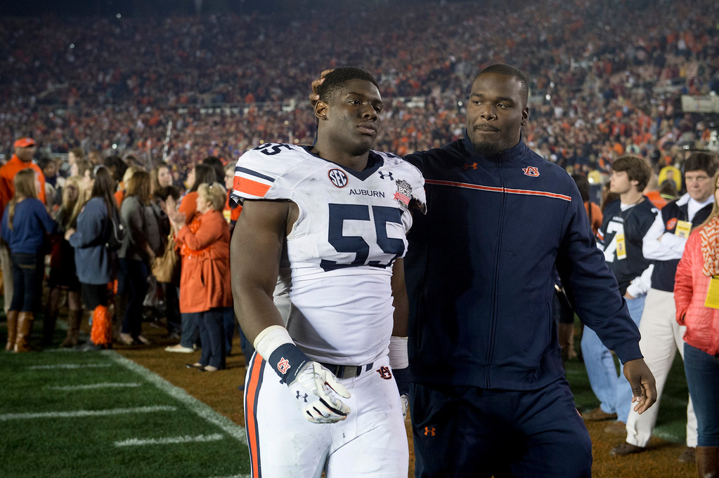 Description of . Auburn's Carl Lawson (55) walks off the field after loosing over Florida State during the BCS National Championship game at the Rose Bowl in Pasadena Calif. on Monday, Jan. 6, 2014. (Watchara Phomicinda/ Pasadena Star-News)