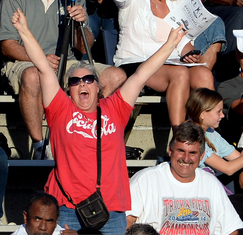 Description of . Fans react during the high jump during the CIF-SS Masters Track and Field meet at Falcon Field on the campus of Cerritos College in Norwalk, Calif., on Friday, May 30, 2014.   (Keith Birmingham/Pasadena Star-News)