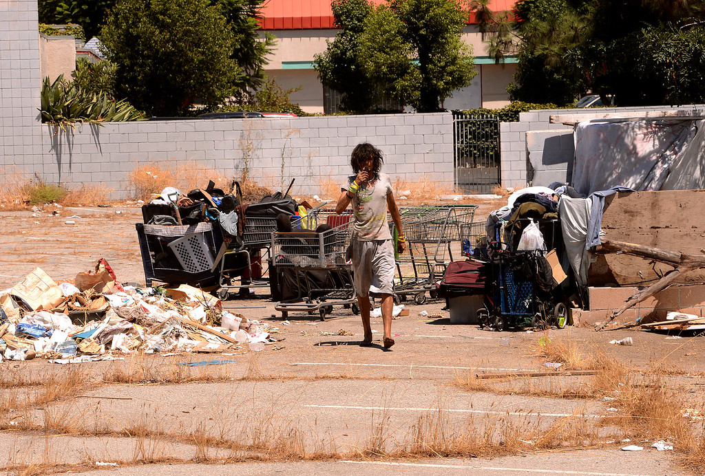 Description of . Troy Miles, 27, emerges from the homeless camp he lives in located near Del Rosa Avenue in San Bernardino August 14, 2013. GABREL LUIS ACOSTA/STAFF PHOTOGRAPHER.