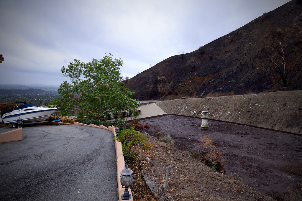 Description of . Englewild Debris Basin in Glendora is about half full as seen Saturday, March 1, 2014 and is expected to hold out through the duration of the storm. The basin is one of four key debris basins in the Colby Fire burn area.  (Photo by Sarah Reingewirtz/Pasadena Star-News)