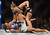 UFC womens bantamweight champion Ronda Rousey punches  challenger Liz Carmouche during their UFC 157 match at the Honda Center in Anaheim, CA Saturday, February 23, 2013. Rousey beat Carmouche via first round submission. (Hans Gutknecht/Staff Photographer)