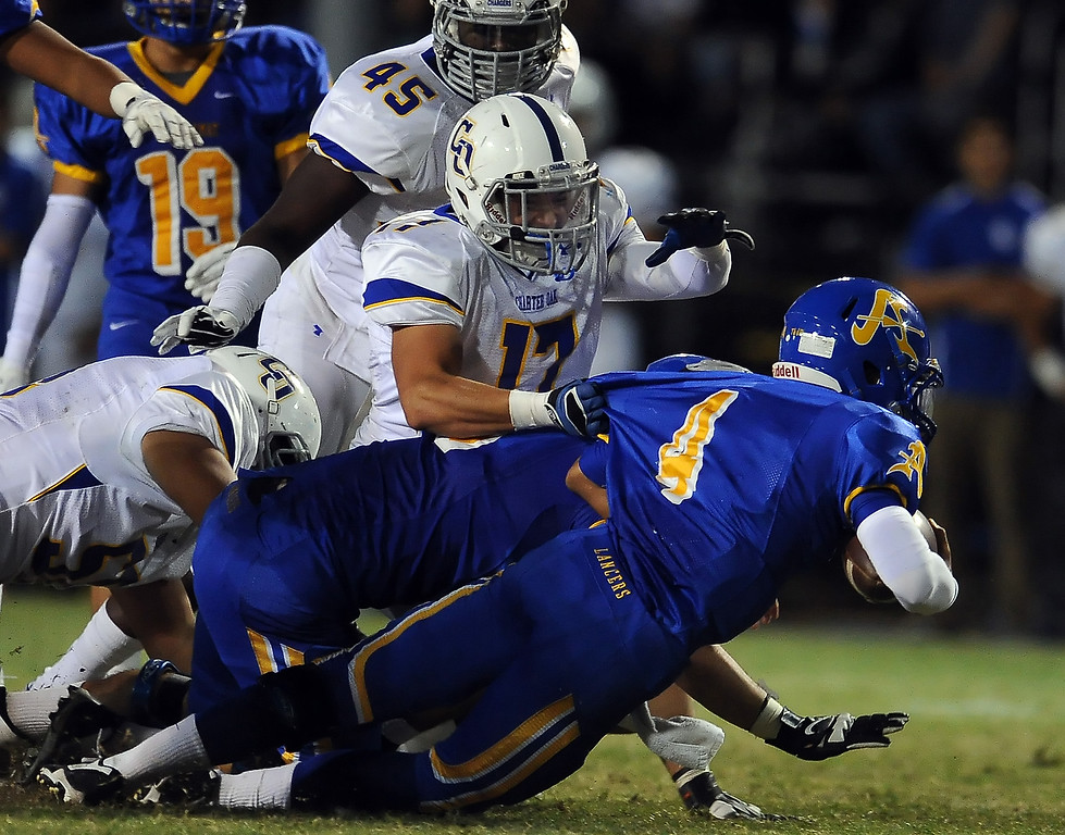 Description of . Bishop Amat's Koa Haynes (C) (4) dives for the first down ahead of Charter Oak's Jason Ortiz (17) in the first half of a prep football game at Bishop Amat High School in La Puente, Calif. on Friday, Sept. 20, 2013.    (Photo by Keith Birmingham/Pasadena Star-News)