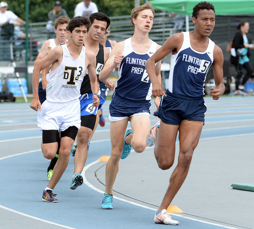 Description of . Flintridge Prep competes in the division 4 1600 meter run during the CIF Southern Section track and final Championships at Cerritos College in Norwalk, Calif., Saturday, May 24, 2014. 