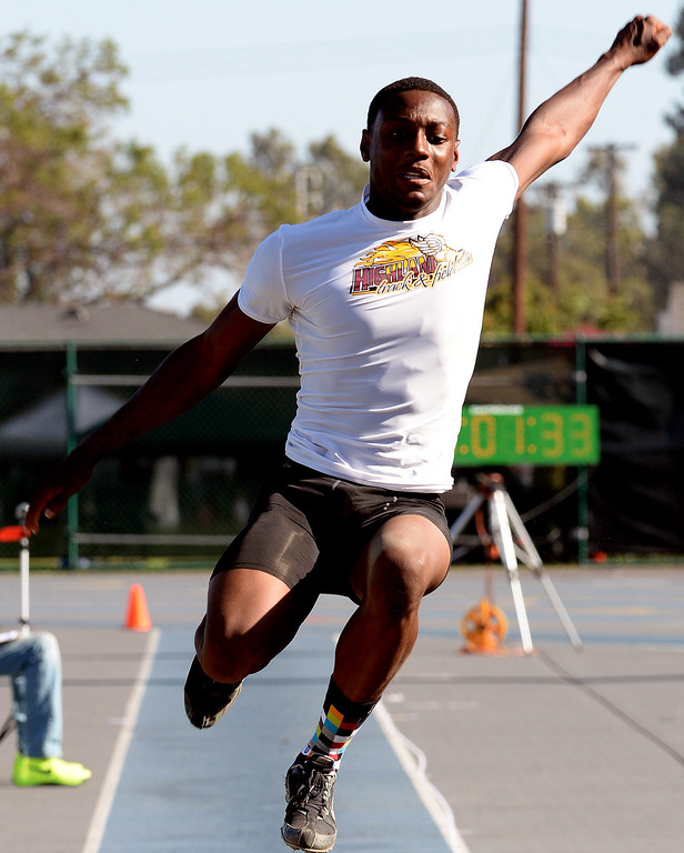 Description of . Highland's Jamire Jordan competes in the long jump during the CIF-SS Masters Track and Field meet at Falcon Field on the campus of Cerritos College in Norwalk, Calif., on Friday, May 30, 2014.   (Keith Birmingham/Pasadena Star-News)