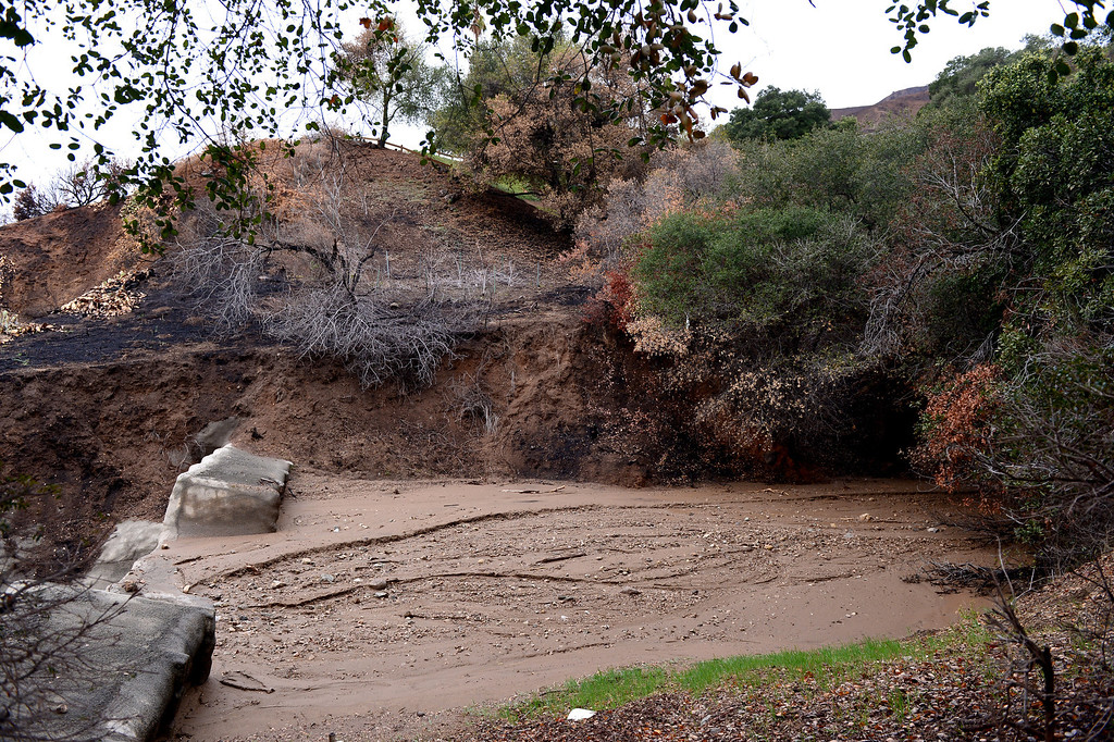 Description of . The low head basins above Rainbow Drive and in the Colby Fire burn area in Glendora are full of mud Saturday, March 1, 2014. (Photo by Sarah Reingewirtz/Pasadena Star-News)