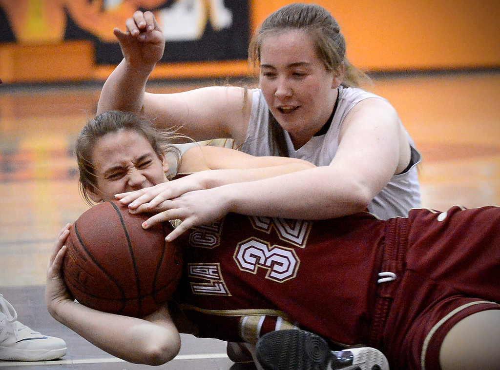 Description of . La Canada's Alyssa Miller (32) and Sophia Hathaway (54) struggle over a loose ball as South Pasadena defeats La Canada 66-58 Friday night, January 31, 2014 at South Pasadena High School. (Photo by Sarah Reingewirtz/Pasadena Star-News)