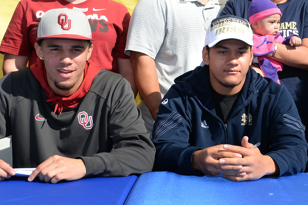 Description of . Football players, from left, Dallis Todd, Oklahoma, and Tyler Luatua, Notre Dame, during National Signing Day at La Mirada High School on Wednesday February 5, 2014. (Staff Photo by Keith Durflinger/Whittier Daily News)