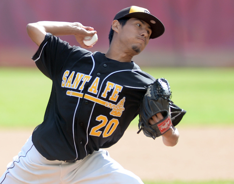 Description of . Santa Fe's Martin Serna (#20) makes a pitch as they play La Serna in their Del Rio League baseball game at La Serna High School in Whittier on Wednesday April 2, 2014. Santa Fe defeated La Serna 2-0. (Staff Photo by Keith Durflinger/Whittier Daily News)