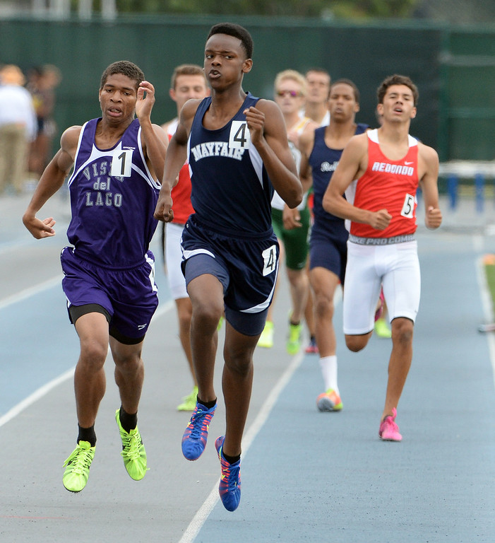 Description of . Mayfair's Ellis Newton wins the division 2 800 meters race during the CIF Southern Section track and final Championships at Cerritos College in Norwalk, Calif., Saturday, May 24, 2014. 