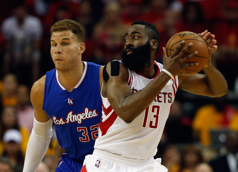 James Harden #13 of the Houston Rockets takes the ball by Blake Griffin #32 of the Los Angeles Clippers during Game Five of the Western Conference Semifinals at the Toyota Center for the 2015 NBA Playoffs on May 12, 2015 in Houston, Texas.   The Rockets won 124-103. (Photo by Scott Halleran/Getty Images)
