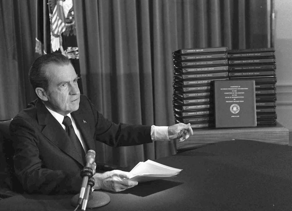 Description of . President Richard M. Nixon is shown pointing to the transcripts of the White House tapes in this April 29, 1974, file photo, after he announced during a nationally-televised speech that he would turn over the transcripts to House impeachment invesigators. 30 years ago, on Aug. 9, 1974, US-President Richard M. Nixon resigned due to the Watergate affair. (AP Photo)