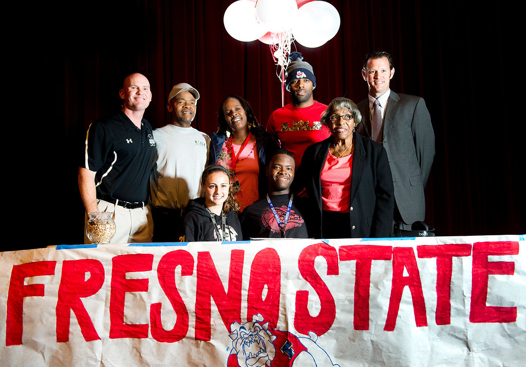 Description of . Monrovia football player DeShawn Potts, 17, signs his national letter of intent to Fresno State during a ceremony at Monrovia High School on Wednesday, Feb. 5, 2014. (Photo by Watchara Phomicinda/ Pasadena Star-News)