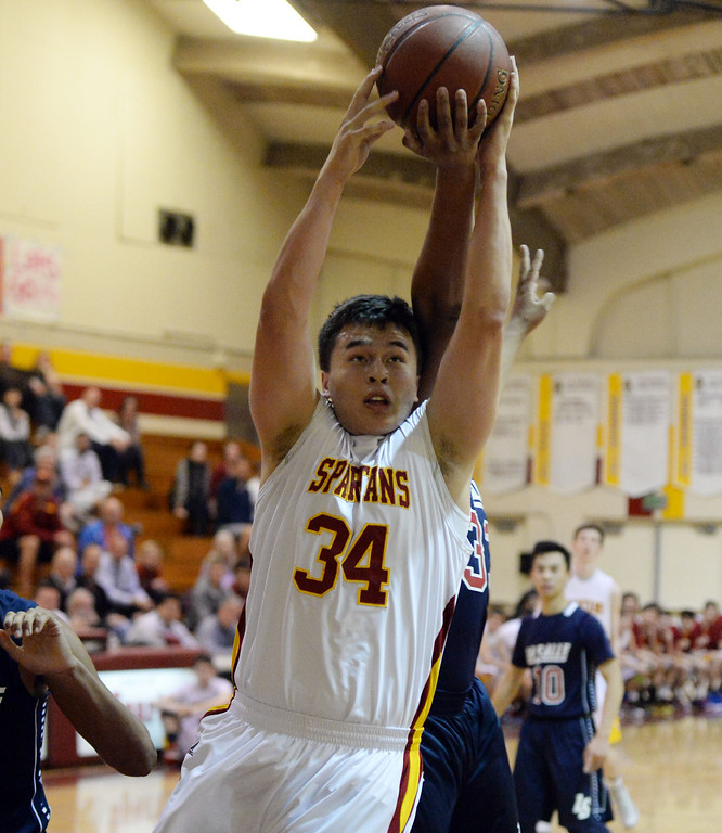 Description of . La Canada's Kyle Thomas (34) rebounds in front of La Salle's Chris Robinson in the first half of a prep basketball game at La Canada High School in La Canada, Calif., on Friday, Jan. 10, 2014. La Canada won 73-62. (Keith Birmingham Pasadena Star-News)
