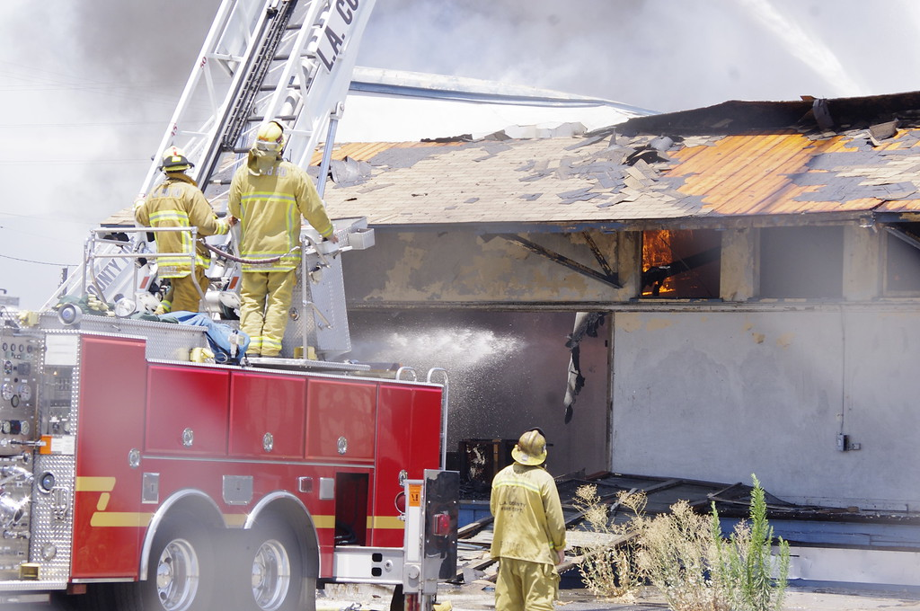 Description of . Firefighters work to knock down the last of a fire which destroyed a warehouse in Industry Tuesday afternoon.