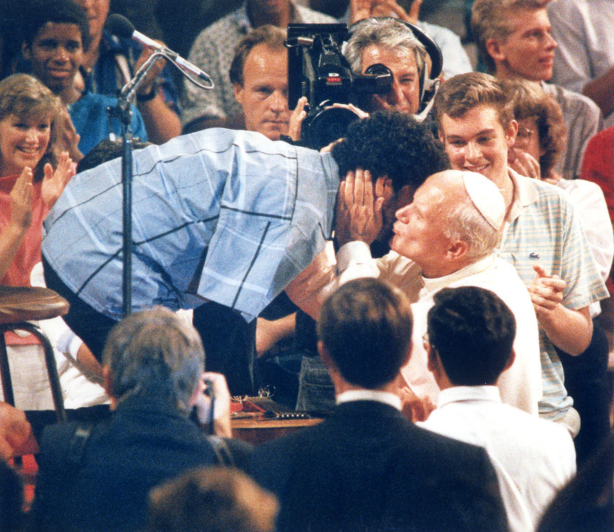 Description of . 9/15/87: Pope John Paul II kisses 25 year old Tony Melendez from Chino. Melendez, who is armless, played guitar with his feet and sang for the Pope at a youth rally at the Universal Amphitheatre.   (L.A. Daily News file photo)