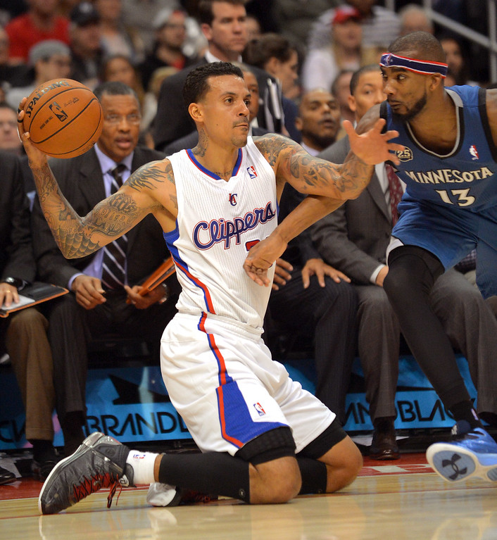 Description of . Los Angeles Clippers' Matt Barnes recovers a loose ball under pressure from Corey Brewer of the Minnesota Timberwolves Monday, Nov. 11, 2013, in Los Angeles.(Andy Holzman/Los Angeles Daily News)