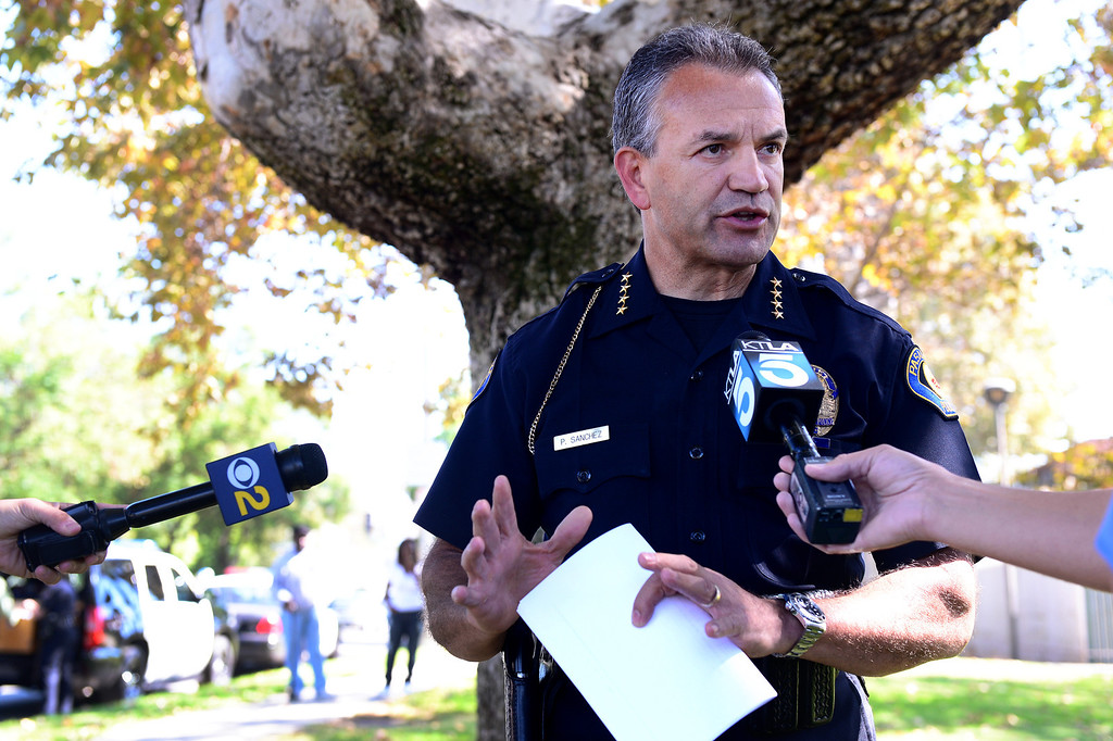 Description of . Pasadena Police Chief Phillip Sanchez talks to the press  as Pasadena Police investigate an officer involved shooting at Kings Village in Pasadena Friday, October 11, 2013. (Photo by Sarah Reingewirtz/Pasadena-Star News)