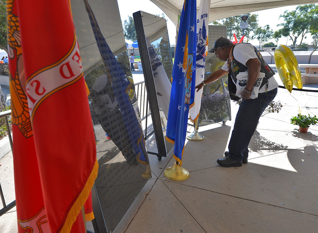Description of . City of Carson Veterans Day Celebration at Veterans Park Monday November 11, 2013  Visitor at Memorial wall.  Photo by: Robert Casillas / Daily Breeze