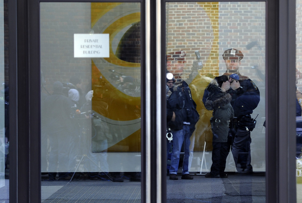 Description of . New York City Police are reflected in the door of the apartment building of fashion designer L'Wren Scott, the girlfriend of Rolling Stones frontman Mick Jagger, after she was found dead at her apartment in New York on March 17, 2014. A spokesman said Jagger, 70, was