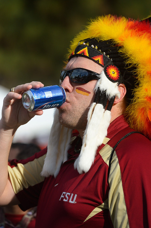 Description of . Dave Phillips, from Panama City Florida, has a drink before the BCS game at the Rose Bowl, Monday, January 6, 2014. (Photo by Michael Owen Baker/L.A. Daily News)