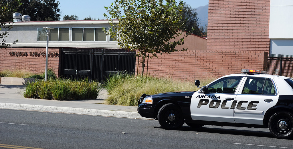 Description of . Arcadia Police unit sits in front after a lockdown at Arcadia High School in Arcadia, Calif. on Thursday, Sept. 12, 2013.   (Photo by Keith Birmingham/Pasadena Star-News)