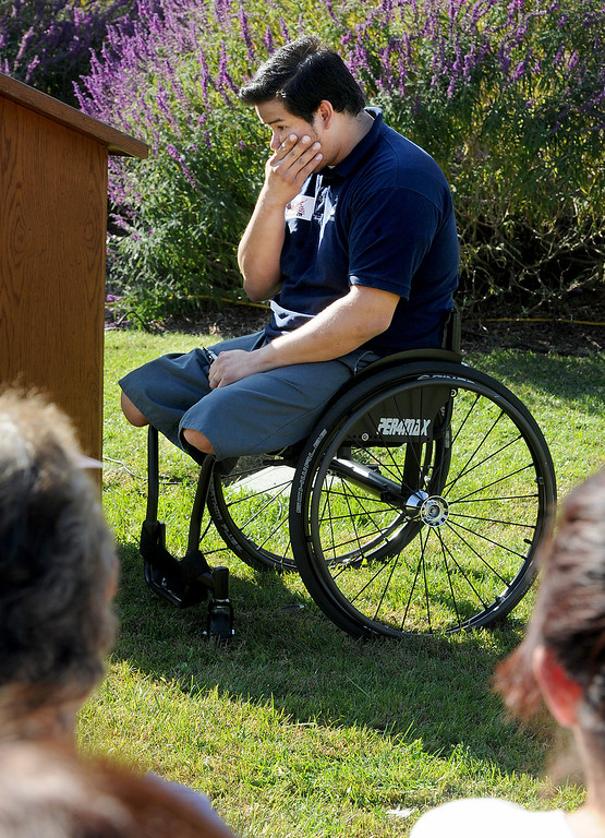 Description of . Carlos Garcia, emotionally speaking of the deaths of his fellow soldiers in Afghanistan. Garcia, a Corporal United States Marine Corps City and a Veteran of War in Afghanistan who lost both of his legs during combat was one of the guests speakers at Duarte Veteran's Day ceremony atThorsen Park Monday, November 11, 2013. (Photo by Walt Mancini/Pasadena Star-News)