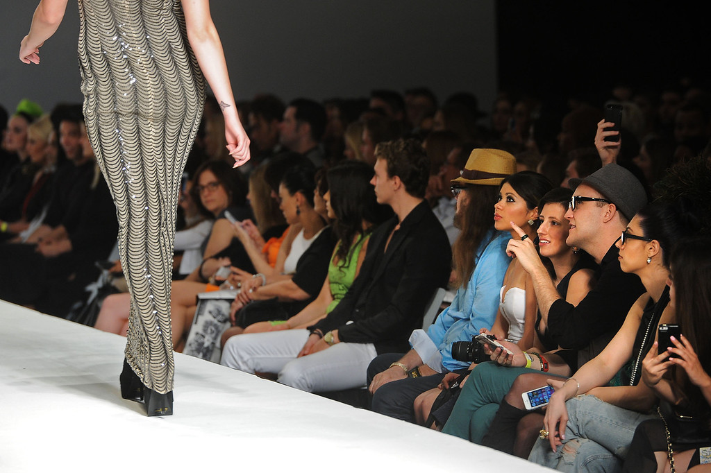 Description of . A model walks the runway at the Andre Soriano fashion show during L.A. Fashion Week March 10, 2014 in Los Angeles, CA.(Andy Holzman/Los Angeles Daily News)