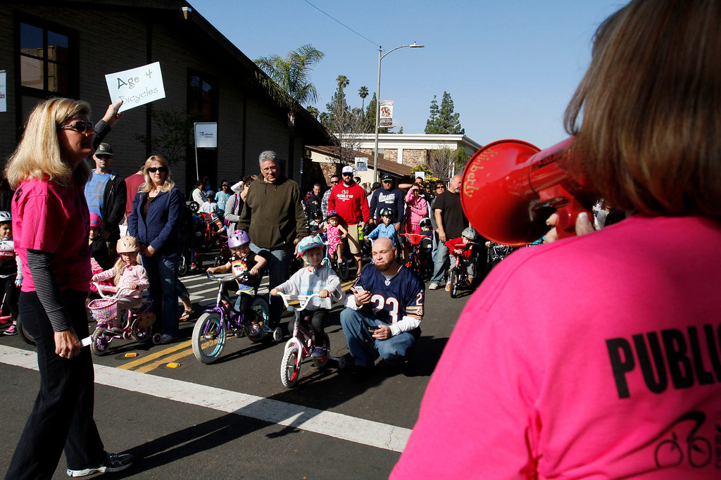 Description of . Riders wait to participate in the public race portion of the Redlands Bicycle Classic on Saturday, April 5, 2014 in Redlands, Ca. (Photo by Micah Escamilla for the Redlands Daily Facts)