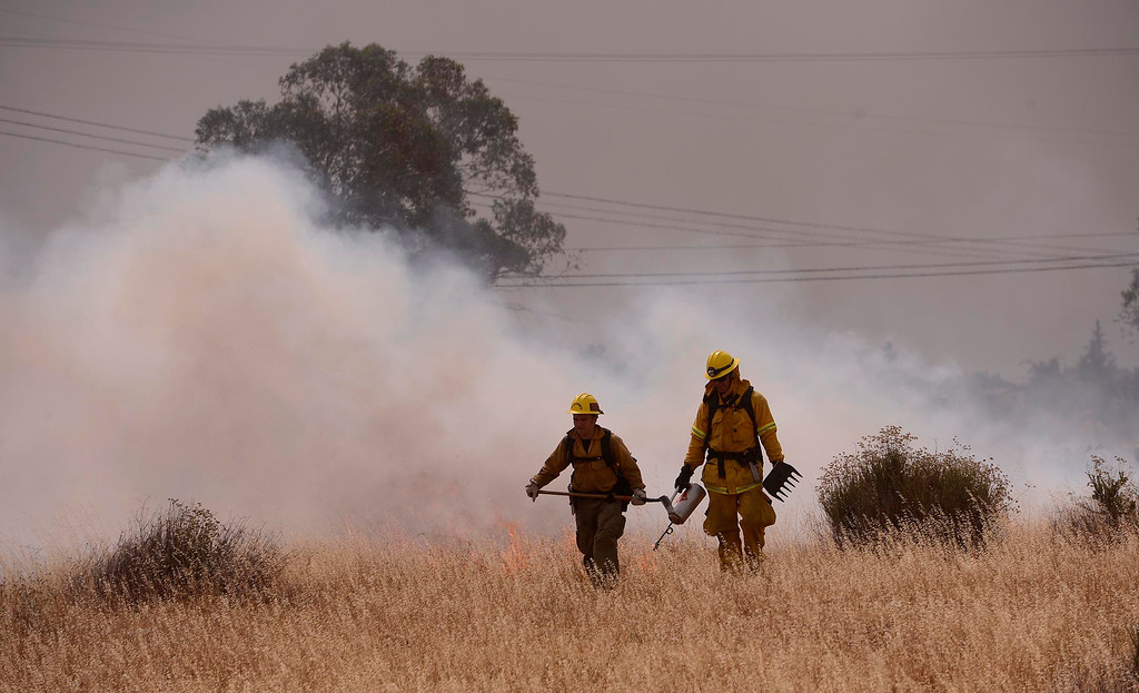 Description of . A scene from a training fire along Sierra Avenue north of Summit Avenue in North Fontana May 23, 2013.  GABRIEL LUIS ACOSTA/STAFF PHOTOGRAPHER.