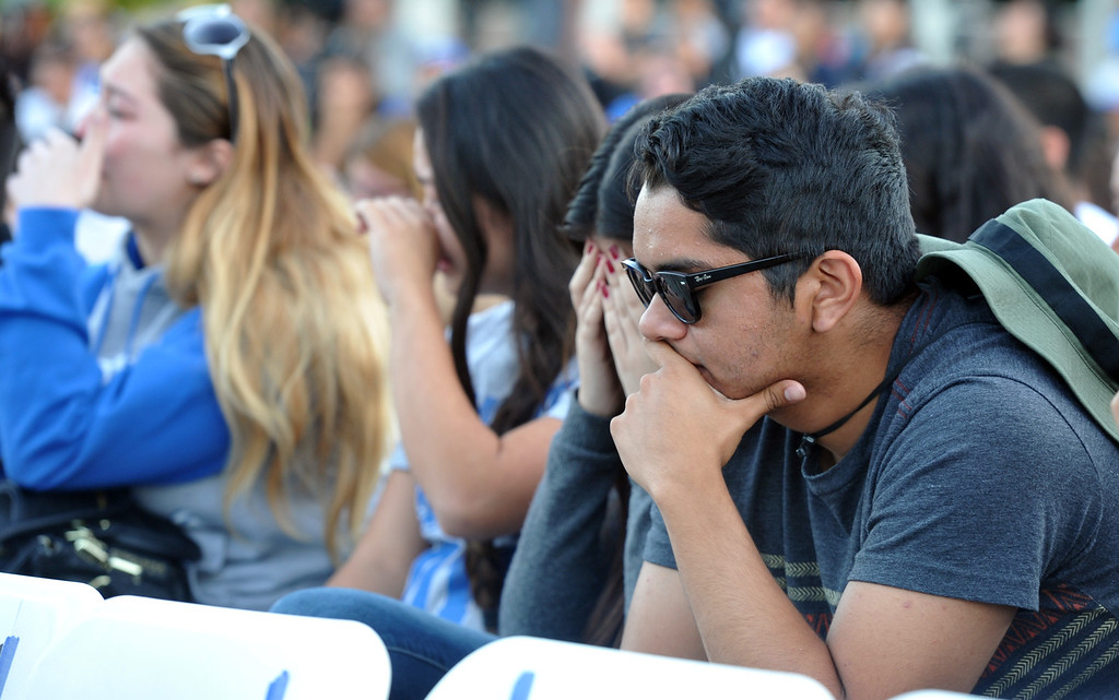 Description of . Family, students and members of the community gather in memory of Adrian Castro, 19, at El Monte High School Monday evening April 14, 2014. Castro was one of nine students killed in the bus crash in Orland, Calif. (Staff Photo by Keith Durflinger/San Gabriel Valley Tribune)