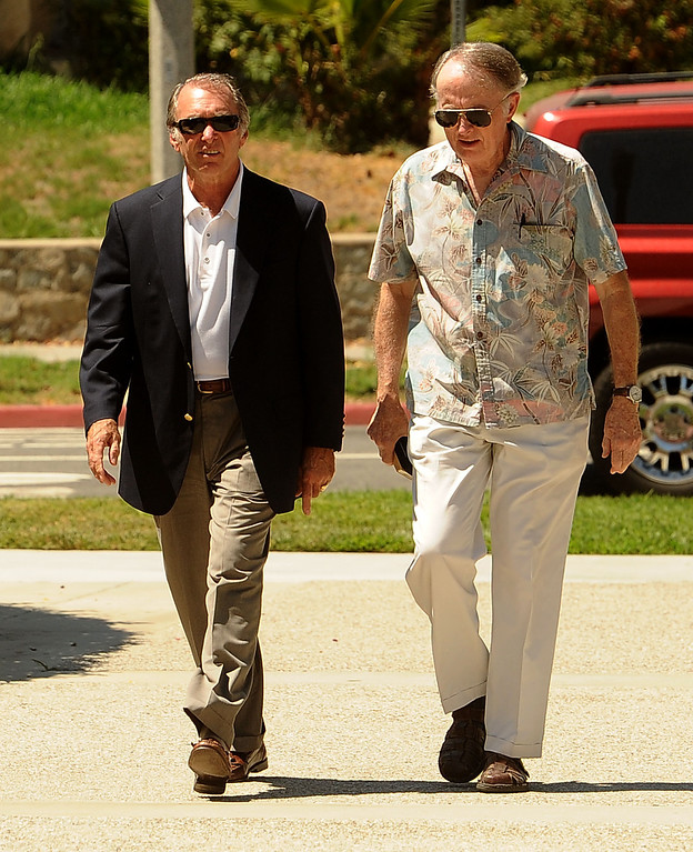 Description of . San Bernardino city councilman Fred Shorett, left, and an unidentified man, arrive to the United States Bankruptcy court in Riverside August 28,2013.  A tentative ruling by a Federal judge grants San Bernardino bankrupty protection.  GABRIEL LUIS ACOSTA/STAFF PHOTOGRAPHER.