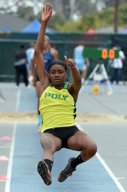 Description of . Long Beach Poly's Zhane Smith competes in the division 1 long jump during the CIF Southern Section track and final Championships at Cerritos College in Norwalk, Calif., on Saturday, May 24, 2014. 