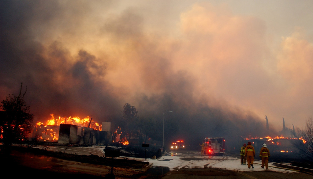 Description of . Ten years ago this month the arson caused Old Fire, fanned by Santa Ana winds burned thousands of acres, destroyed hundreds of homes and caused six deaths. The fire burned homes in San Bernardino, Highland, Cedar Glen, Crestline, Running Springs and Lake Arrowhead and forced the evacuation of thousand of residents.  Homes in a San Bernardino neighborhood burn. (Staff file photo/The Sun)