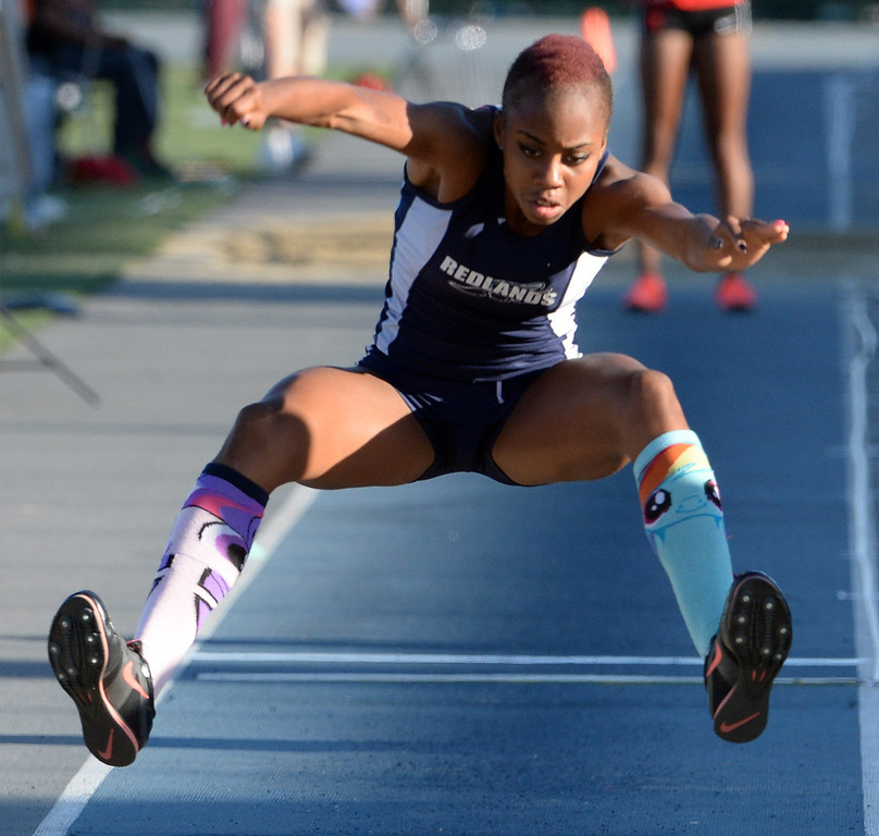 Description of . Redland's Juanita Webster competes in the Triple Jump during the CIF-SS Masters Track and Field meet at Falcon Field on the campus of Cerritos College in Norwalk, Calif., on Friday, May 30, 2014.   (Keith Birmingham/Pasadena Star-News)