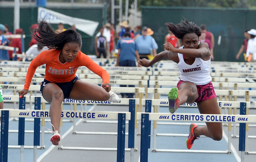 Description of . Roosevelt's Jasmyne Graham, left, with Jaela Williams compete in the division 1 100 meter high hurdles during the CIF Southern Section track and final Championships at Cerritos College in Norwalk, Calif., Saturday, May 24, 2014. 