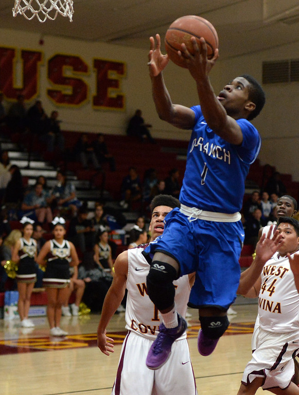 Description of . Diamond Ranch's Ernest Ugoagu (1) drives to the basket against West Covina in the first half of a prep basketball game at West Covina High School in West Covina, Calif., on Wednesday, Jan. 8, 2014. (Keith Birmingham Pasadena Star-News)