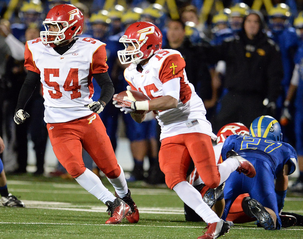 Description of . Paraclete's Triston Brown (15) runs for yardage against San Dimas in the first half of a CIF-SS Mid-Valley Division championship football game at San Dimas High School in San Dimas, Calif., on Friday, Dec. 6, 2013.   (Keith Birmingham Pasadena Star-News)