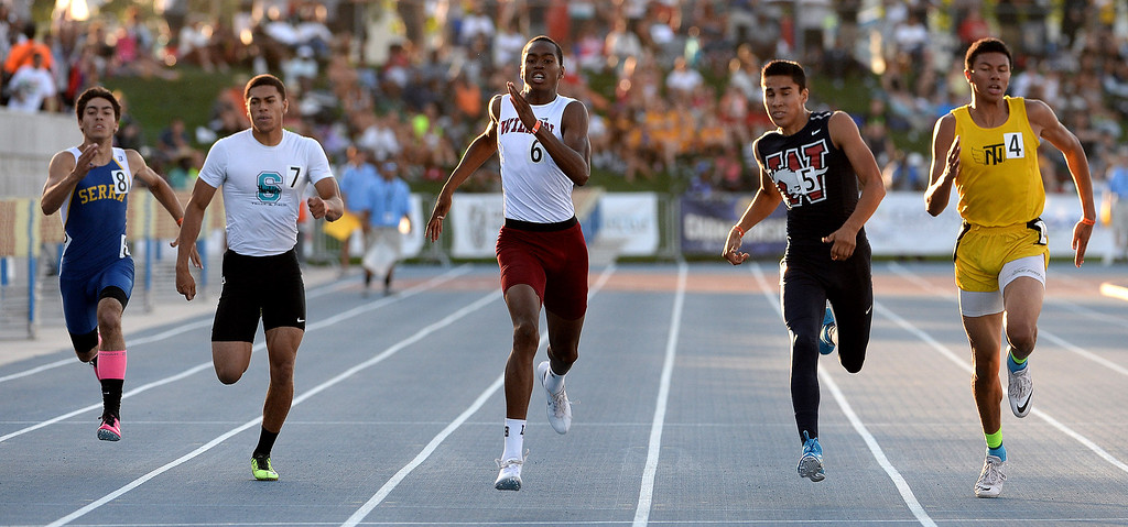 Description of . Long Beach Wilson's Kemonie Briggs, center, wins the 400 meter dash during the CIF California State Track & Field Championships at Veteran's Memorial Stadium on the campus of Buchanan High School in Clovis, Calif., on Saturday, June 7, 2014. 